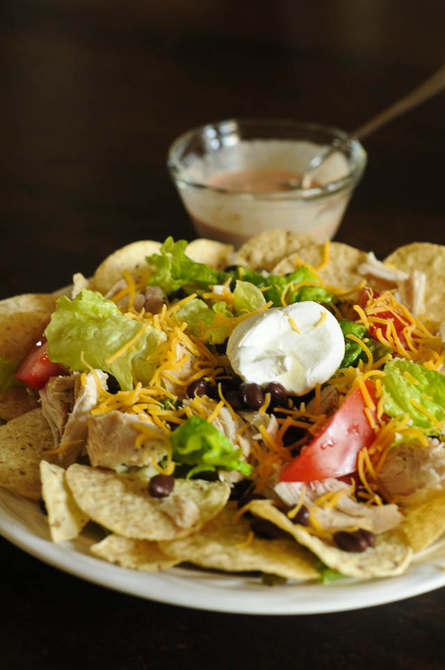 Chicken Nachos - Quick, easy and delicious, these chicken nachos are always a favorite! // addapinch.com
