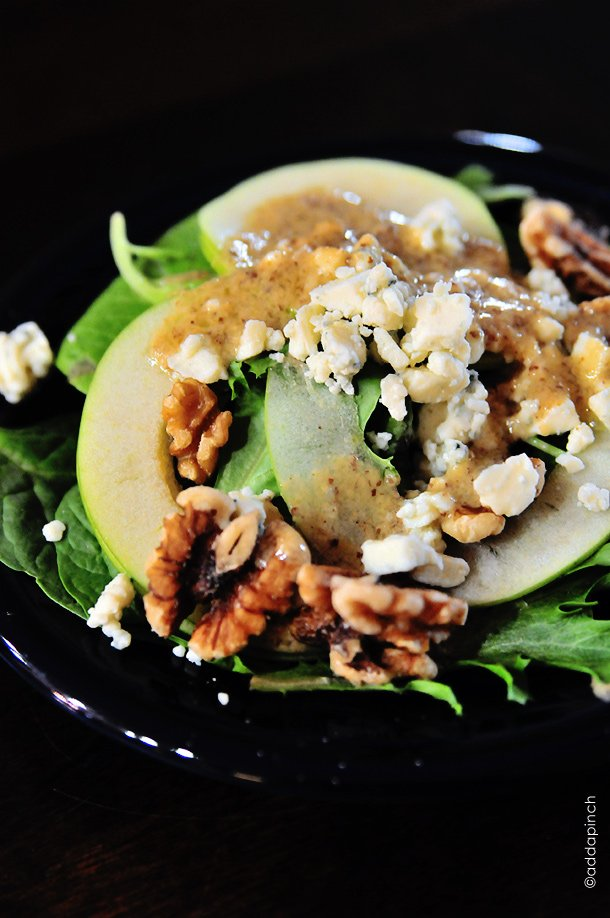 Apple Walnut Salad is a delicious blend of spinach, tart juicy apples, walnuts and creamy bleu cheese crumbles. It is simply perfect for fall. // addapinch.com