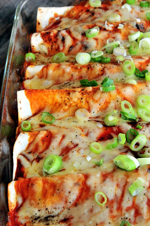 Chicken Enchiladas make a perfect weeknight meal! Seriously the BEST chicken enchiladas recipe and one the whole family will love! addapinch.com
