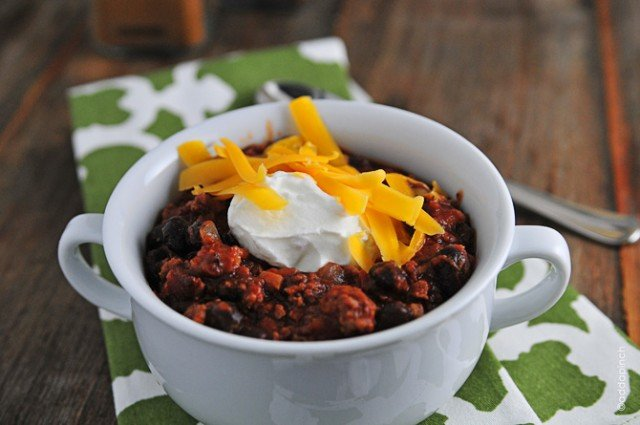 Black Bean Chili Recipe - Black Bean Chili is perfect for a quick-fix weeknight supper. Ready in 30 minutes, this chili is full of ground beef, black beans, and tons of flavor! // addapinch.com