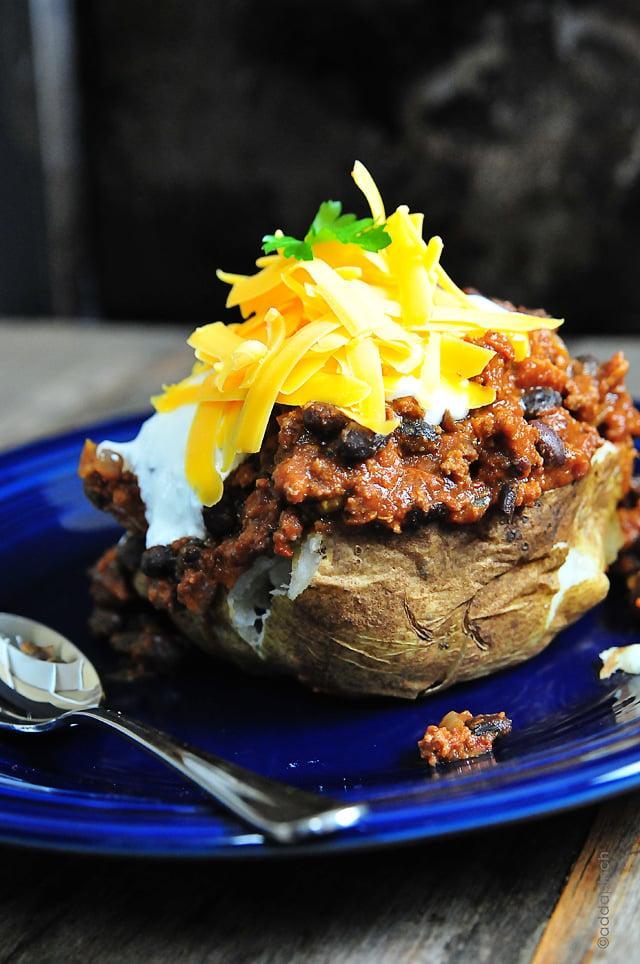 Chili Stuffed Baked Potatoes | addapinch.com