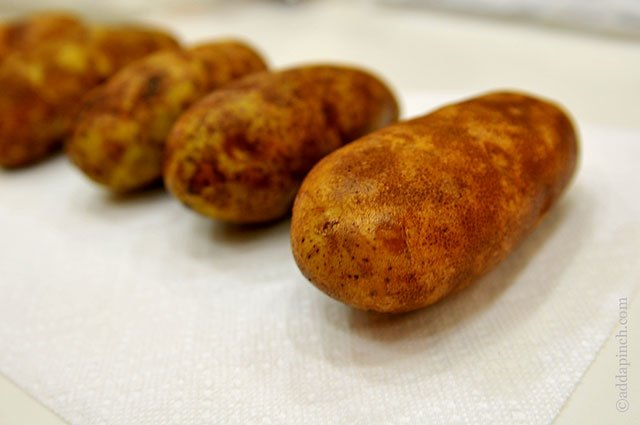 Slow Cooker Baked Potatoes | ©addapinch.com