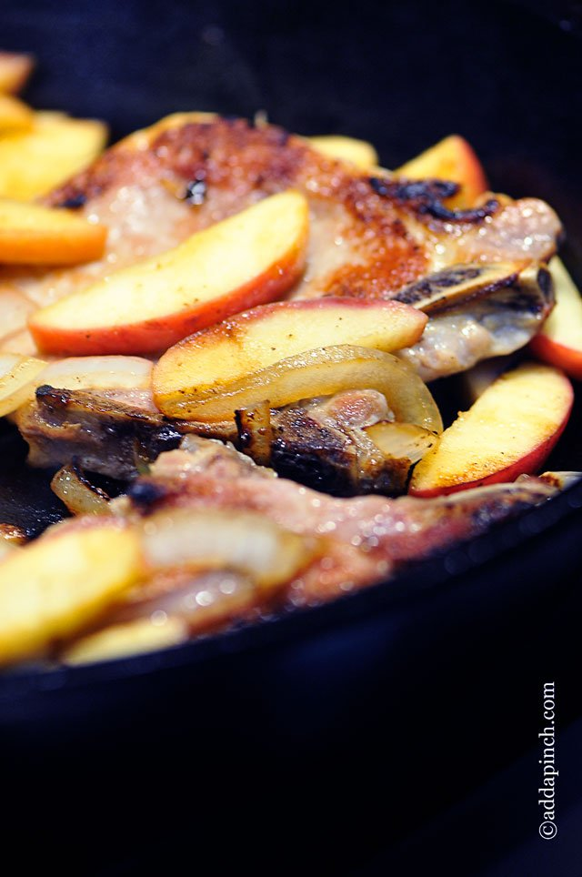 Pork Chops with Apples and Onions Recipe | ©addapinch.com