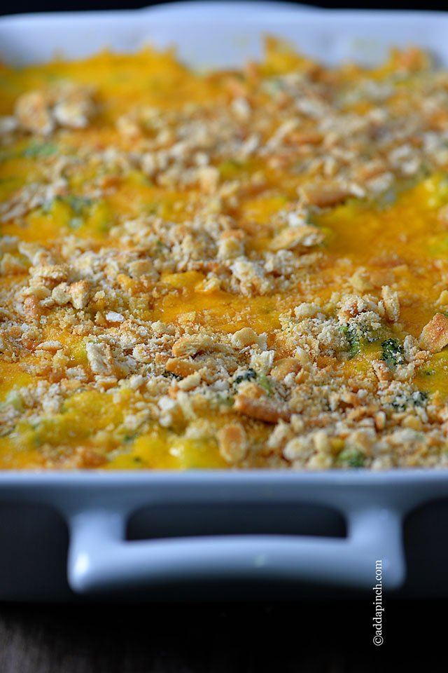 Large casserole dish of Broccoli Cheese Casserole from addapinch.com