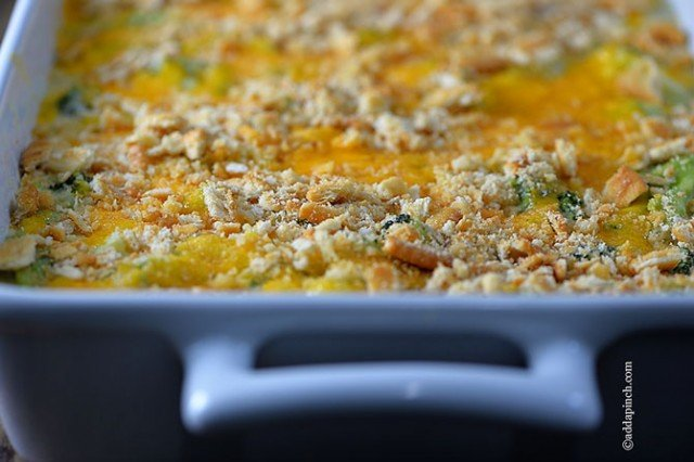 Broccoli Cheese Casserole in white dish with handles - addapinch.com