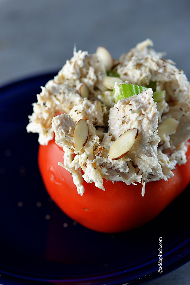 Chicken Salad Stuffed Tomatoes from addapinch.com