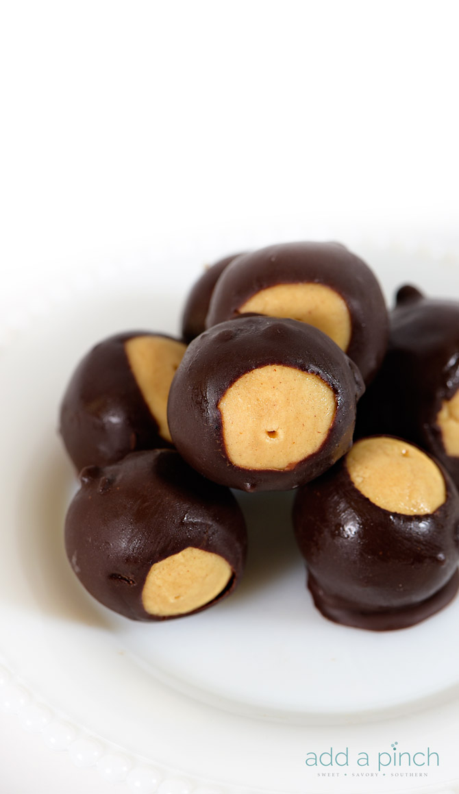 Buckeyes makes a favorite peanut butter and chocolate candy. Named for the nut of the same name, buckeyes are loved through the holidays and all year. // addapinch.com