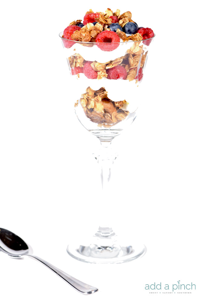 This simple parfait recipe is made of five ingredients and ready in five minutes or less! You'll make this parfait recipe again and again. // addapinch.com
