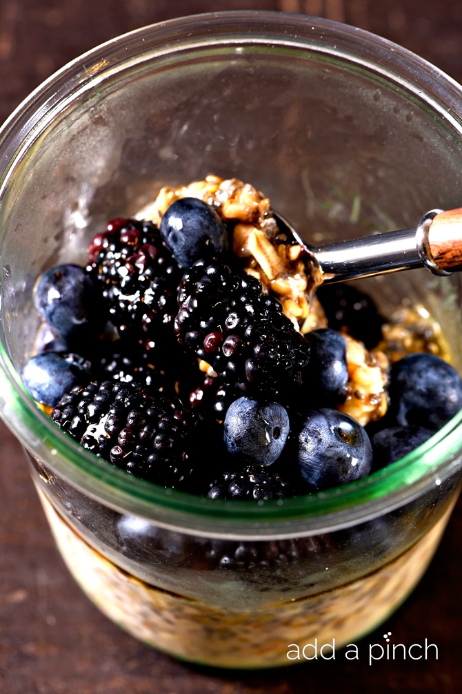This maple berry overnight oats recipe is a busy family's friend! Perfect for those rushed mornings or for a grab and go breakfast! // addapinch.com