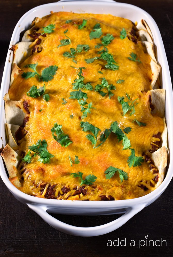 This easy beef and bean enchilada comes together quickly for a delicious recipe perfect for a weeknight supper! // addapinch.com