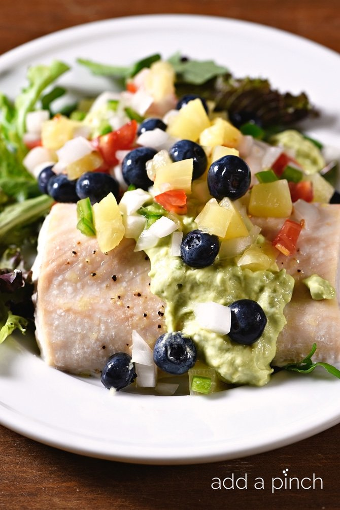 Mahi Mahi with Pineapple Blueberry Salsa makes a delicious, quick and easy meal perfect for a weeknight supper or entertaining! // addapinch.com