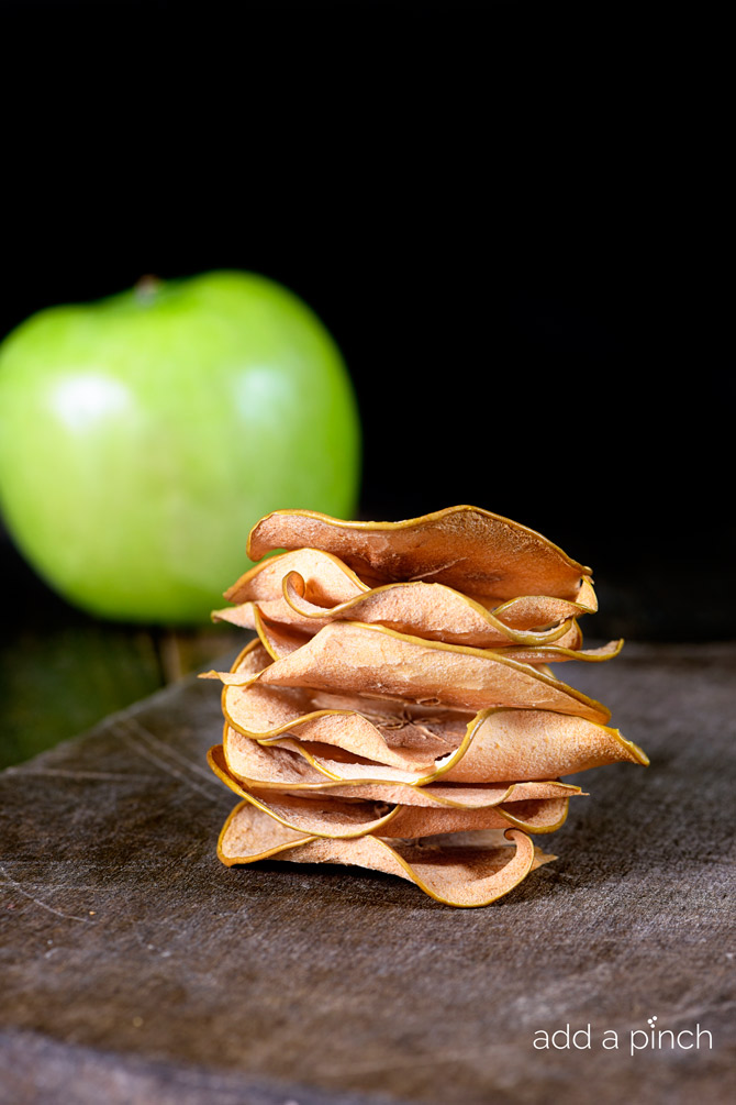 Baked apple chips are so simple to make at home! Crispy and delicious, these apple chips are addictive! // addapinch.com