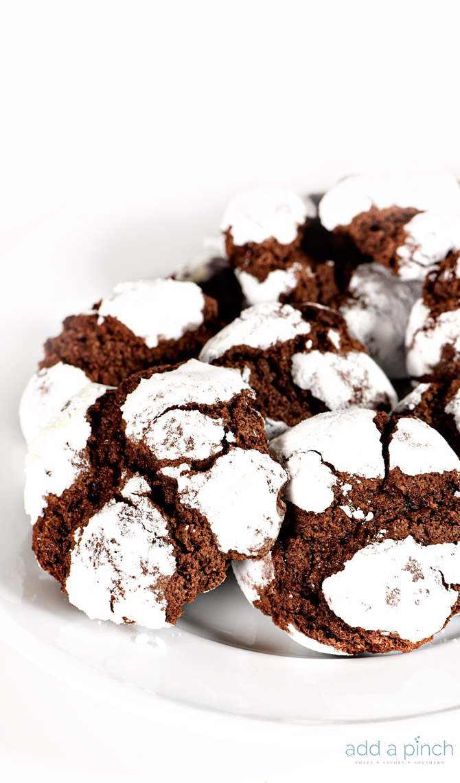Chocolate Crinkle Cookies Recipe - Chocolate crinkle cookies coated in powdered sugar and baked into a soft, chewy, delicious chocolate cookie! What's not to love! // addapinch.com