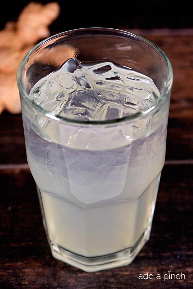This Homemade Ginger Ale recipe takes a few minutes, but is well worth the time! The flavors of the fresh ginger shine through and make this one glass of ginger ale you won't want to miss! // addapinch.com