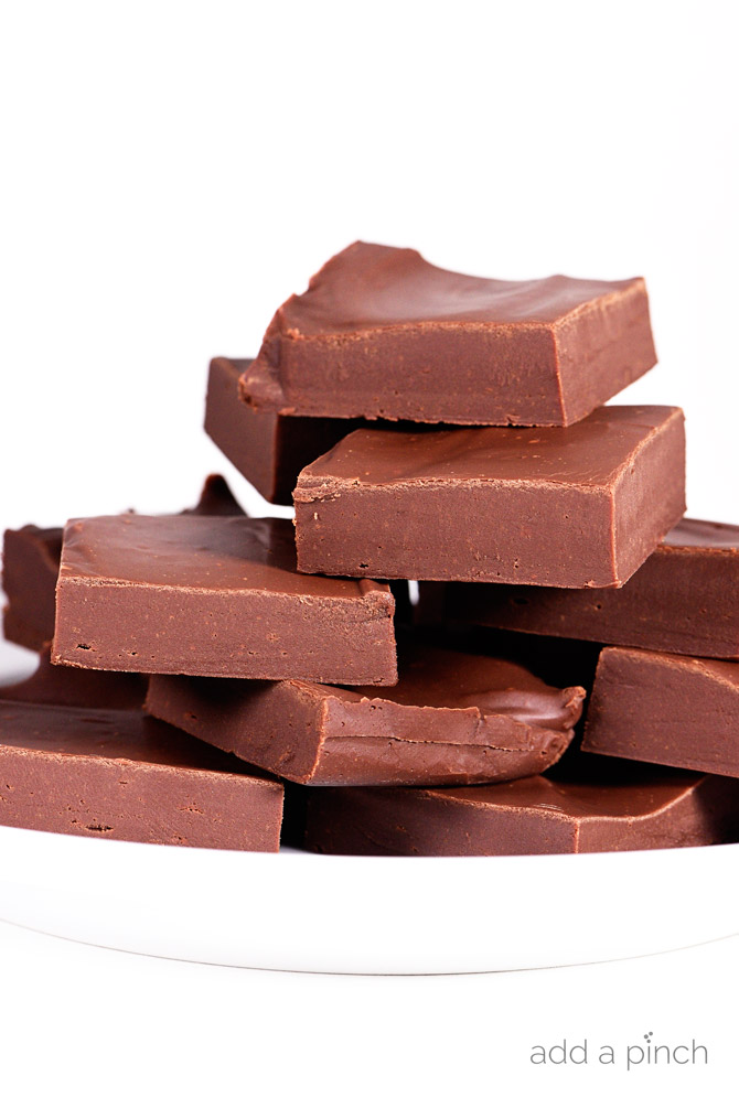 Chocolate Fudge Recipe - Easy chocolate fudge recipe made with just four ingredients! This rich fudge recipe is so simple and perfect to add nuts, candies, cookies, or dried fruit. // addapinch.com