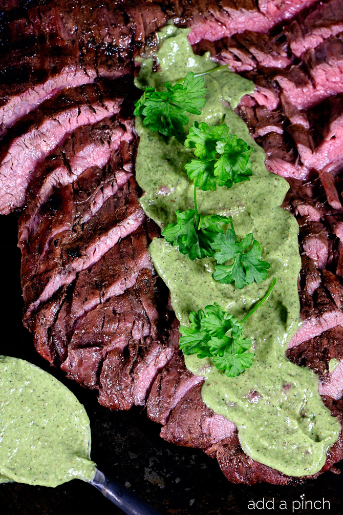 Grilled Flank Steak Recipe served with a chimichurri sauce, this flank steak is a definite favorite! // addapinch.com