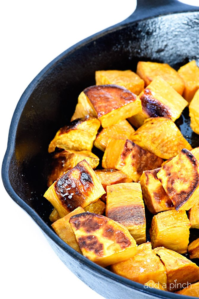 Skillet roasted sweet potatoes make a favorite side dish! Made with just a few ingredients, the skillet makes these sweet potatoes incredibly crisp, yet still tender. // addapinch.com