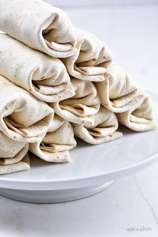 Make-Ahead Breakfast Burritos Recipe - Stock your freezer with these easy make-ahead breakfast burritos for even easier mornings! // addapinch.com