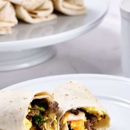 Make-Ahead Breakfast Burritos Recipe - Stock your freezer with these easy make-ahead breakfast burritos for even easier mornings! // addapinch.com