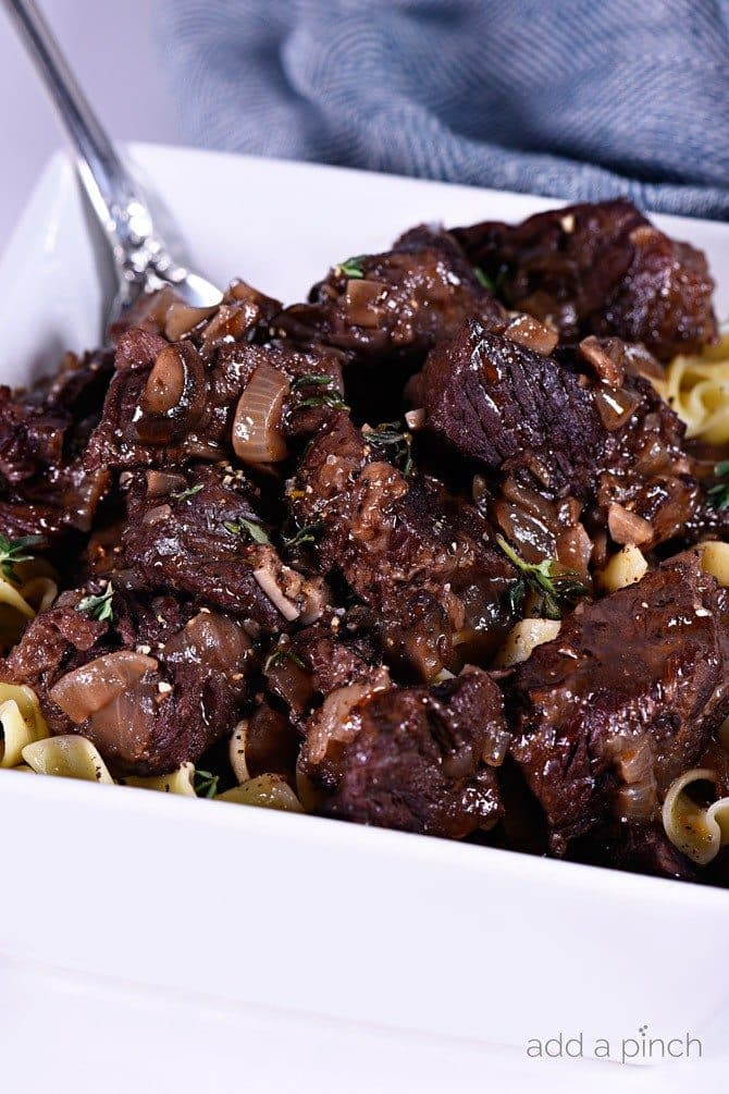 Beef Bourguignon Recipe - Beef Bourguignon makes a classic meal. This simple recipe for making beef bourguignon will quickly become a family-favorite. // addapinch.com