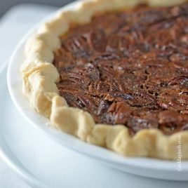 The BEST Pecan Pie Recipe - This Pecan Pie Recipe is a classic in my husband's family. For every family gathering, you better believe there will be pecan pie sitting front and center on the dessert table. Every. single. time. // addapinch.com