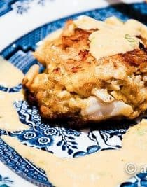 Crab Cakes Recipe - Crab cakes with remoulade sauce makes for a wonderful appetizer for a special occasion dinner or even a main dish attraction served with a salad or vegetables. // addapinch.com