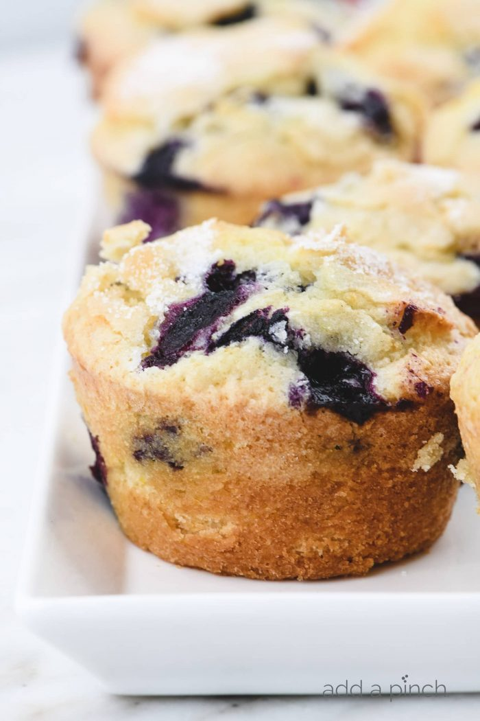 Blueberry Muffins Recipe - This easy, one bowl recipe makes the best blueberry muffins! Bursting with blueberries under a sparkling sugar topping! // addapinch.com