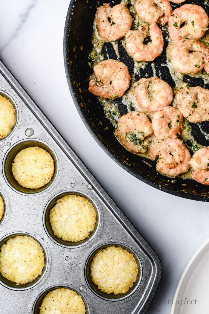 Shrimp and Grits Bites are a bite-sized version of the all-time favorite shrimp and grits. Made in a mini muffin tin and perfectly portioned for entertaining, parties, tailgates and more! // addapinch.com
