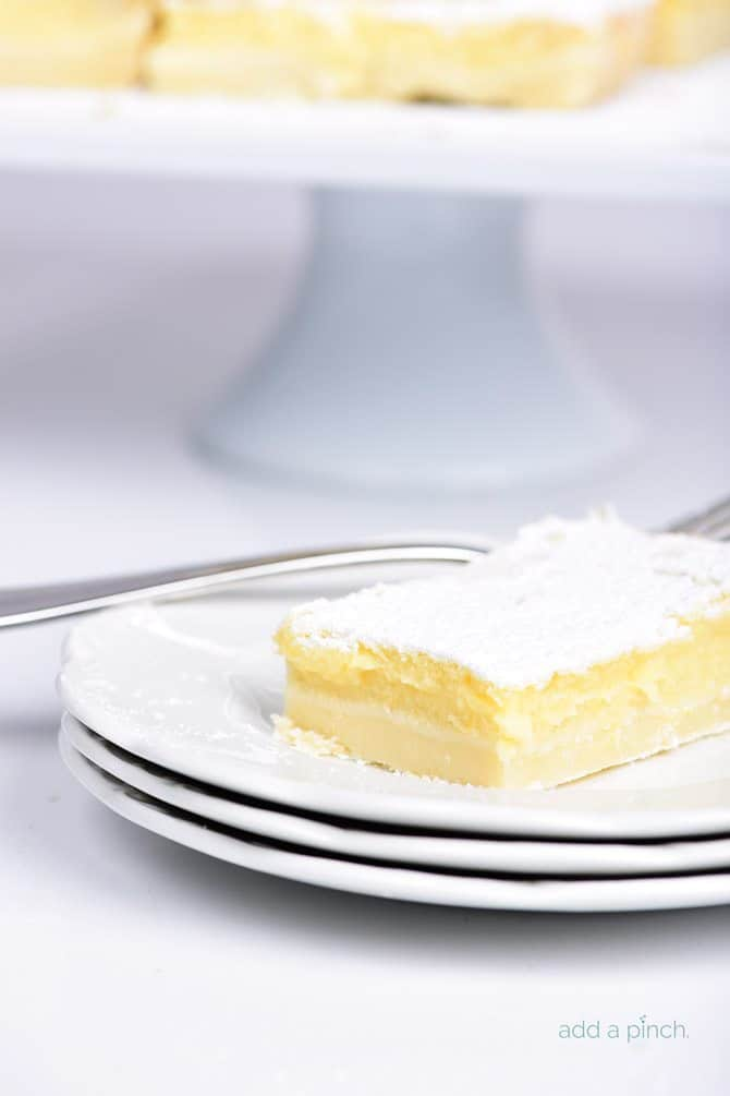Easy Lemon Bars Recipe - This easy Lemon Bars recipe makes a delicious sweet treat! Layered onto a shortbread crust, this tart, yet sweet lemon bar is perfect for the lemon lover! // addapinch.com
