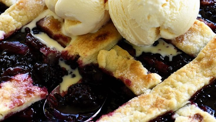 Southern Blackberry Cobbler Recipe - This blackberry cobbler makes a classic dessert. Including a lattice top and pastry dumplings, this blackberry cobbler is a favorite. // addapinch.com