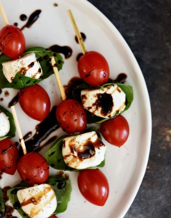 Caprese Salad Skewers Recipe - Caprese Salad Skewers make a delicious appetizer to serve when entertaining. Fresh and easy, these caprese salad skewers will become a go-to favorite! // addapinch.com