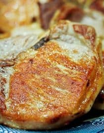 Skillet pork chops recipe - ready in less than 30 minutes. Makes a perfect busy weeknight meal.