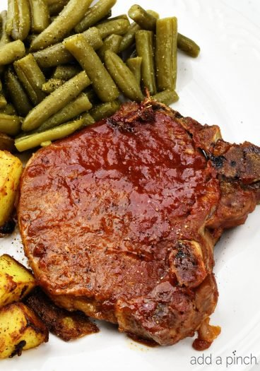 Slow Cooker BBQ Pork Chops - The slow cooker makes these pork chops fork tender and a family favorite! Just 5 minutes of prep time make this a favorite weeknight meal! // addapinch.com