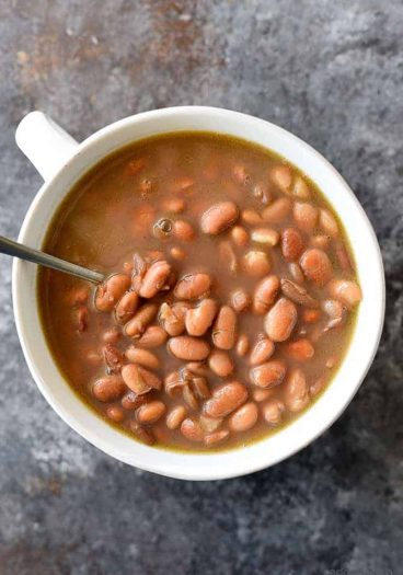 Pinto Beans Recipe - Slow cooked southern pinto beans that are a traditional favorite! Includes stove top, slow cooker and pressure cooker instructions! // addapinch.com