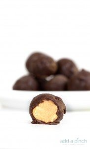 Peanut Butter Balls Recipe - the perfect combination of peanut butter and chocolate! This simple, no-bake recipe makes peanut butter balls everyone loves! // addapinch.com