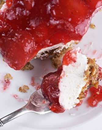 Strawberry Pretzel Salad Recipe - Strawberry Pretzel Salad makes a classic, nostalgic recipe. A creamy, fruity recipe made with strawberry gelatin, cream cheese, whipped topping, and pretzels. It is always a favorite. // addapinch.com