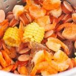 Shrimp Boil Recipe - This classic shrimp boil recipe is a family favorite! Made with fresh shrimp, potatoes, sausage and corn! // addapinch.com