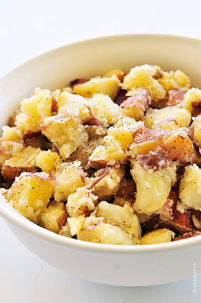 Buttered potatoes are a simple, classic, and comforting side dish recipe. // addapinch.com