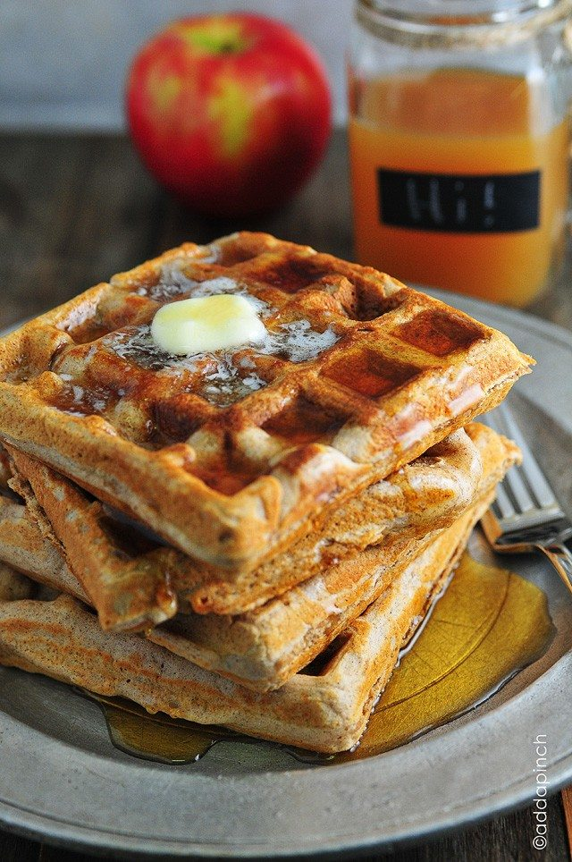 Apple Cider Waffles Recipe - Apple cider waffles are a great addition to your fall and winter breakfast routine. Serve these waffles with warm maple syrup and apple cider for the ultimate breakfast! // addapinch.com