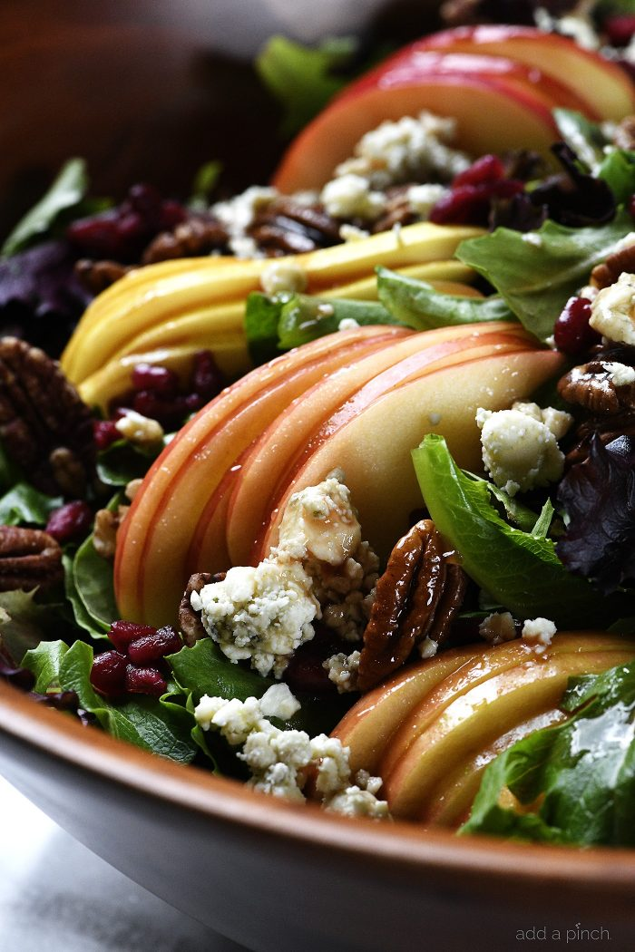 Apple Pear Salad with Pomegranate Vinaigrette with pomegranate arils, blue cheese and roasted nuts - addapinch.com