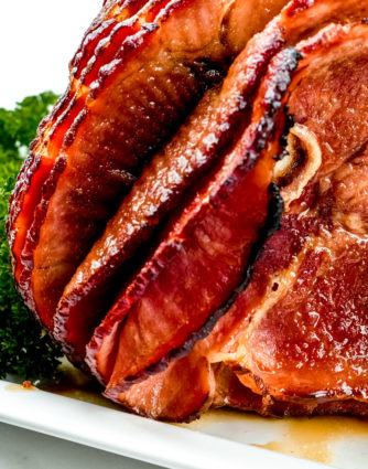 Cola Glazed Ham Recipe - This classic cola glazed hamrecipe with brown sugar makes an easy baked ham perfect for any occasion! // addapinch.com