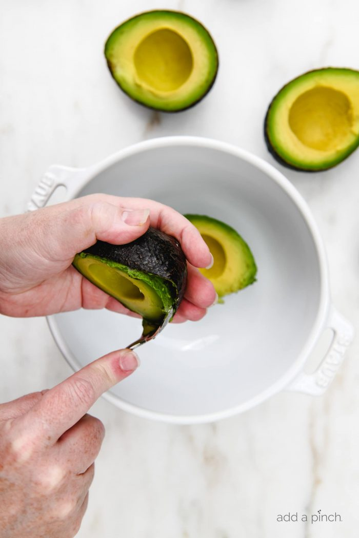 Guacamole Recipe - This simple guacamole comes together in less than 5 minutes and is full of fresh ingredients! Delicious dip and topping to so many dishes! // addapinch.com