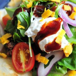 Taco Salad Recipe - Taco salad makes a delicious quick-fix supper or game day meal! This recipe comes together in minutes! // addapinch.com