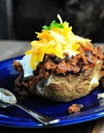 Chili Stuffed Baked Potatoes Recipe - Oh my! These chili stuffed baked potatoes are deee-lish-us! And pretty perfect for the Super Bowl this weekend. // addapinch.com