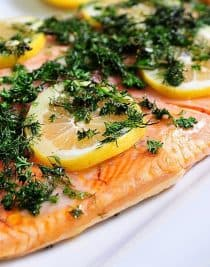 Lemon Dill Salmon Recipe - Ready in less than 30 minutes! Perfect for a light weeknight meal or easy entertaining! // addapinch.com