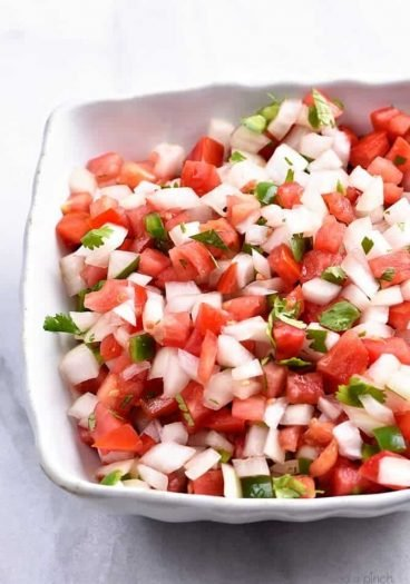 Pico de Gallo Recipe - Pico de Gallo has to be one of the simplest recipes to make and adds so, so, so much flavor to any number of dishes as a topping or just right by itself on a chip! // addapinch.com