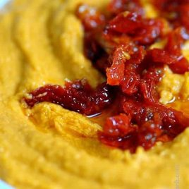 Sundried Tomato Hummus Recipe - Sun Dried Tomato Hummus makes a delectable hummus recipe to make as an appetizer when entertaining. // addapinch.com