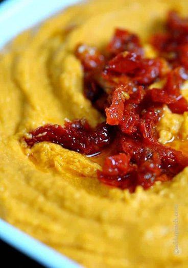 Sundried Tomato Hummus Recipe - Sun Dried Tomato Hummus makes a delectable hummus recipe to make as an appetizer when entertaining. // addapinch.com