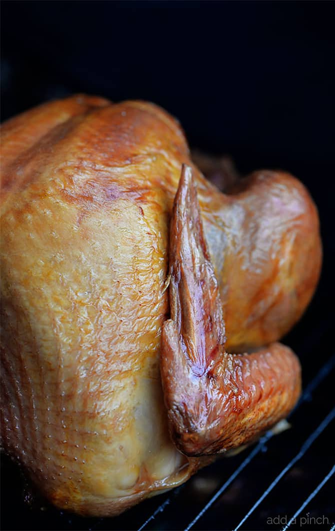 Smoked Turkey Recipe - This simple, yet scrumptious smoked turkey brings the juiciest and most flavorful turkey to your Thanksgiving table.// addapinch.com