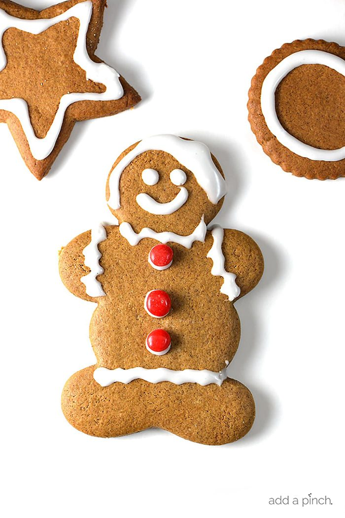 Gingerbread Cookies Recipe - Gingerbread cookies are a favorite Christmas cookie recipe and this gingerbread cookie recipe will become a favorite with a few special ingredients! // addapinch.com